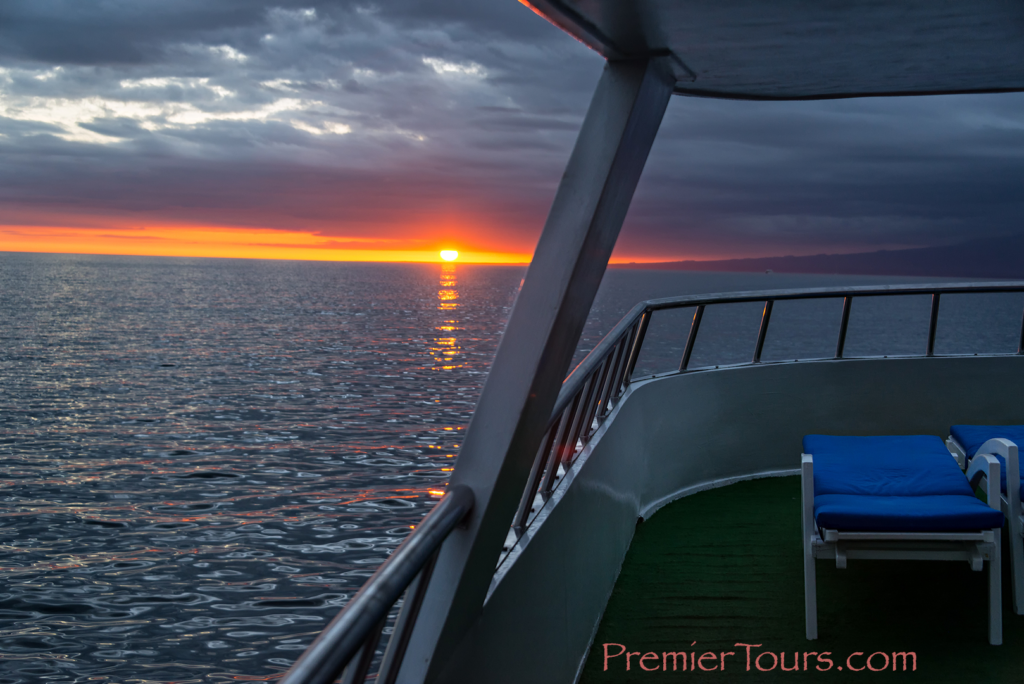 Sunset from a cruise ship deck in the Galapagos - ways to save money in the Galapagos