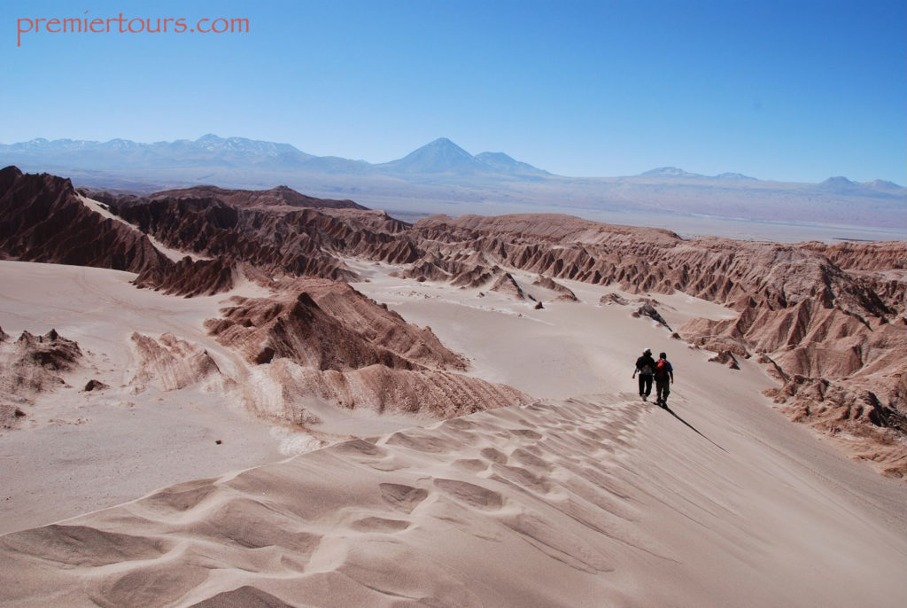 Where to go in Chile - the Atacama Desert - 2 men walking through the desert